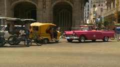 Havana, Cuba. Traffic taxi and pedi-cab - stock footage