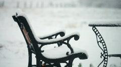 Snowing patio Stock Footage
