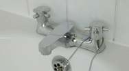 Bath taps turning on and off Stock Footage