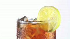 Glass of iced coke with lemon loop - HD  Stock Footage