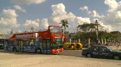 Havana, orange taxi and bus - stock footage