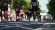 Marathon track shallow DOF Stock Footage