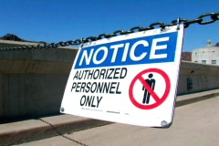 Authorized Personnel Sign Hanging from a Chain Stock Footage