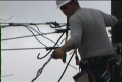 Man Dropping Power Line - stock footage