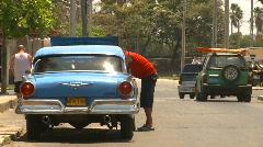 Cuba, old car repair on street Stock Footage