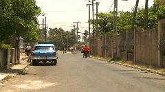 Cuba old car repair street and announcement van Stock Footage