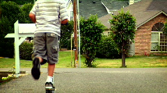 Young Boy on a Scooter Stock Footage