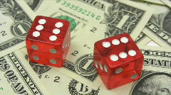Red Dice on Dollars Stock Footage