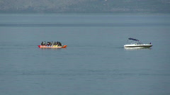 A banana boat with tourists speeds away Stock Footage