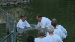 Baptism of pilgrims in the Jordan River Holy Land Israel HD Stock Footage