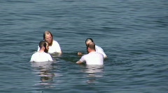 Orthodox Jews practice swimming Stock Footage