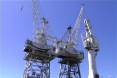 Derrick cranes in harbour Stock Footage