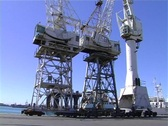 Derrick cranes in harbour Stock Footage