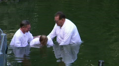 Baptism of pilgrims in the Jordan River Holy Land Israel HD Stock Footage