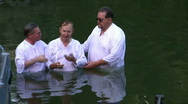 Stock Video Footage of Baptism of pilgrims in the Jordan River Holy Land Israel HD