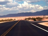 Traveling Fast Along a Desert Road Stock Footage