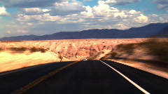 Traveling Fast Along a Desert Road - stock footage