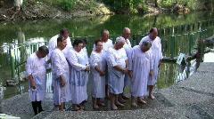 Pilgrims pray after baptising in Jordan River, Holy Land, Israel, HD Stock Footage