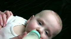 Baby Drinks Bottle - stock footage