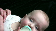 Stock Video Footage of Baby Drinks Bottle