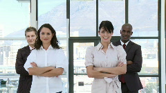 Determinded Businessteam standing with their arms folded - stock footage