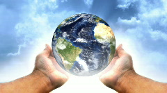 Spinning Earth in a Male Hands LOOP Stock Footage