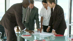 Businessteam discussing about a businessproject - stock footage