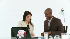 Businessman and woman in discussion Stock Footage