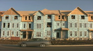 Stock Video Footage of Houses under construction.