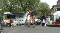 Dancing stilt walker Stock Footage