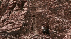 Woman mountain climbing at Red Rock Canyon Stock Footage