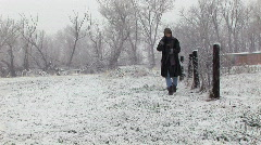 Woman snow walking bible Stock Footage