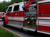 Firetruck Pulling Up at a Massive Fire Stock Footage