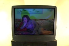 Woman on TV Watching TV - stock footage
