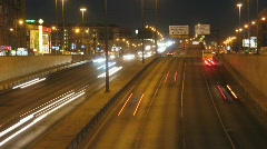 Cars moving on road in night, time lapse Stock Footage