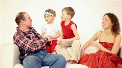 Family four with two children talk Stock Footage
