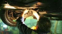 Master repairs car Stock Footage