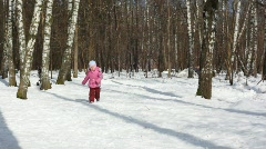 Small girl runs in wood Stock Footage