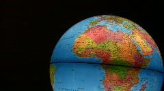 Silhouette of the hand rotates luminous globe Stock Footage
