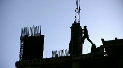 Silhouette worker on construction site - stock footage
