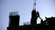 Silhouette worker on construction site Stock Footage