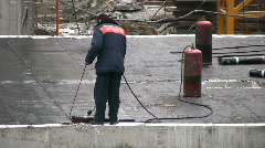 Worker welds covering on roof Stock Footage