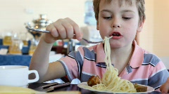 Stock Video Footage of Boy eats noodle