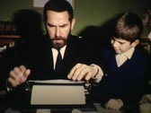 Father using a typewriter vintage Stock Footage
