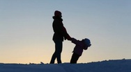Silhouette mother with child falling Stock Footage