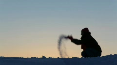 Silhouette of the women plays with snow Stock Footage