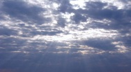 Time lapse clip with sunrays through the clouds Stock Footage