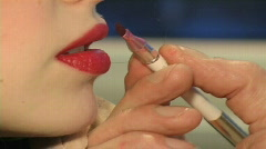 Painting red lips Stock Footage