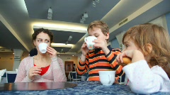 Mother and two children lunch in cafe - stock footage