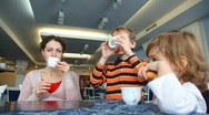 Stock Video Footage of Mother and two children lunch in cafe